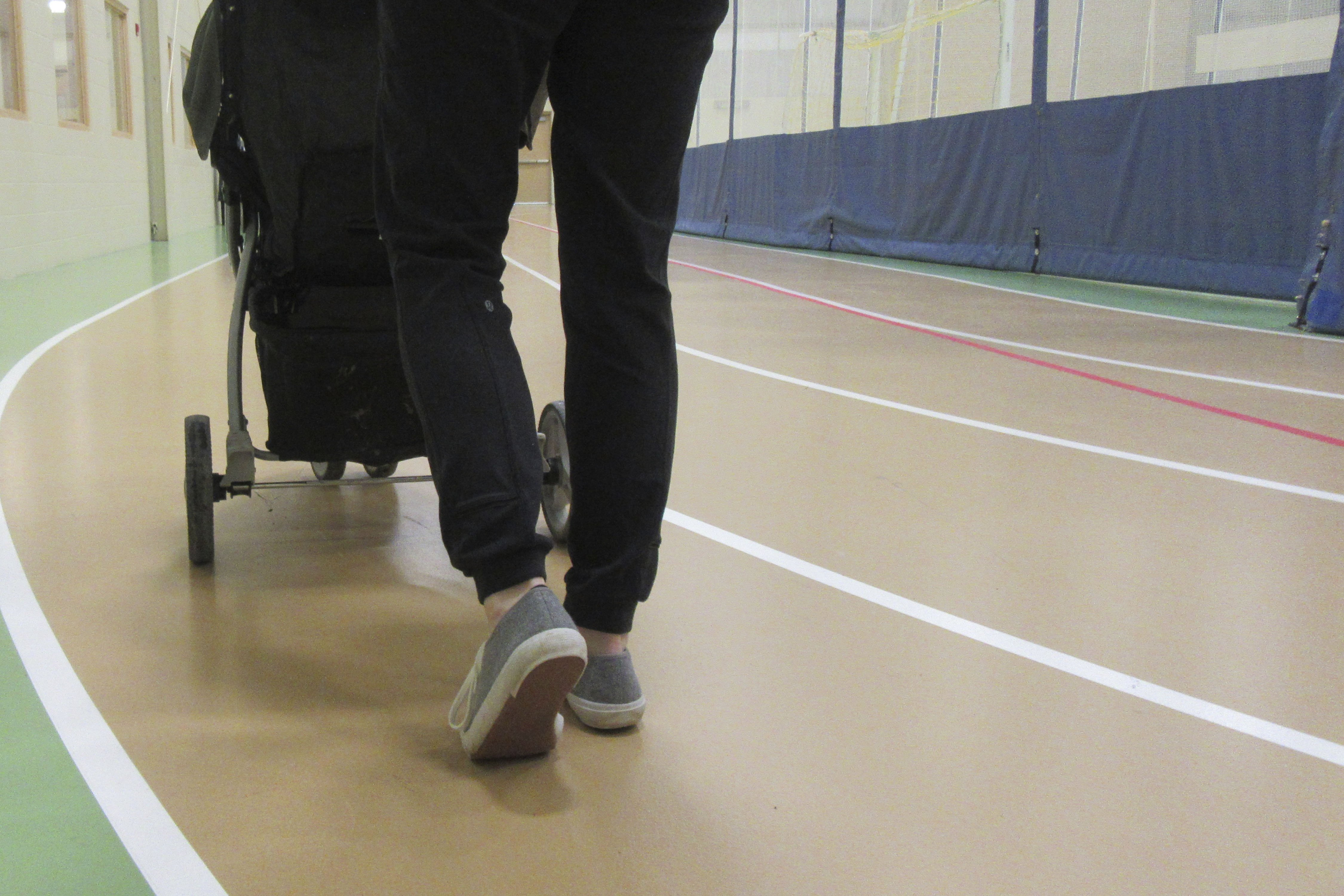 Person walking on indoor track