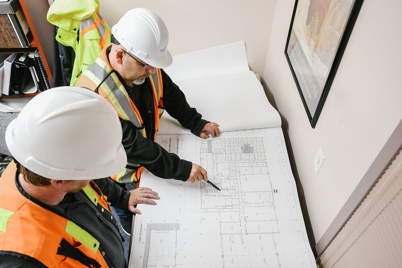 two people looking at construction plans