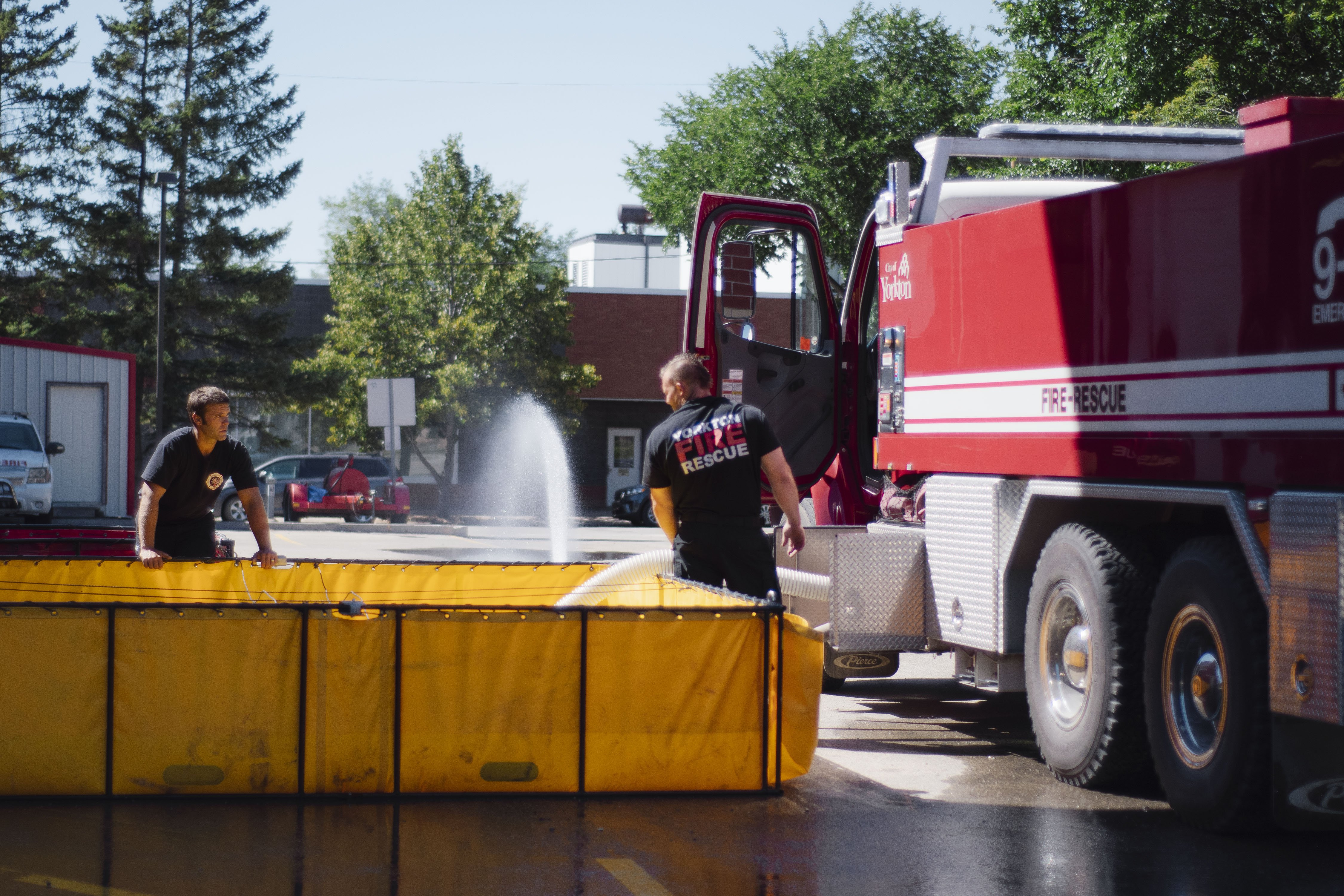 firefighters testing water hose