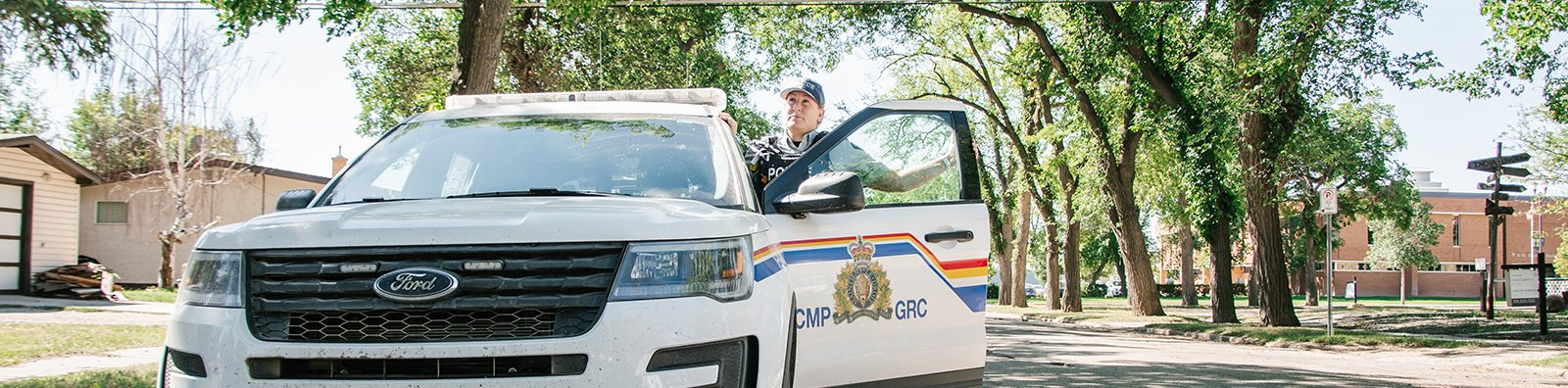RCMP officer with RCMP vehicle